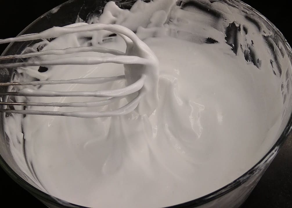 Whisk the whipping cream.